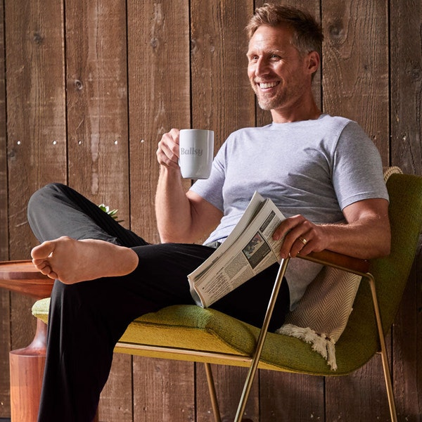 Tommy John Image male model sitting in chair