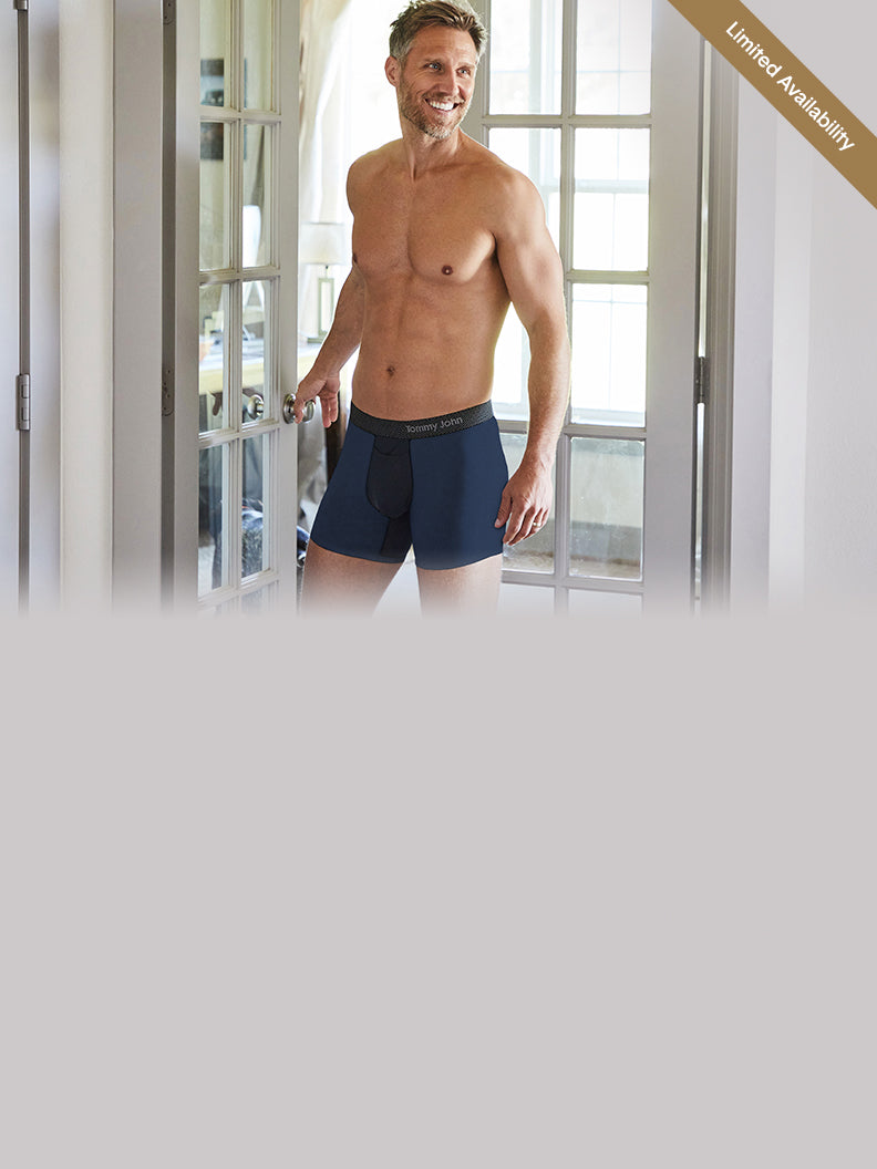Male model in light grey colorblock trunk underwear.
